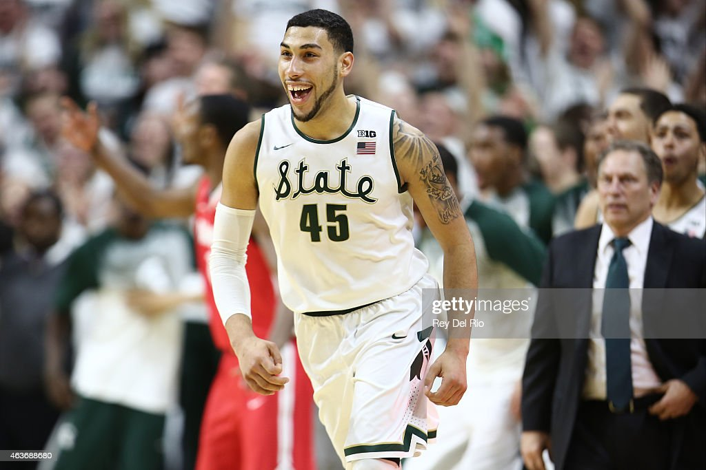 Denzel Valentine #45 of the Michigan State Spartans celebrates after making the game winning three during the game against the Ohio State Buckeyes at the Breslin Center on February 14, 2015 in East Lansing, Michigan.