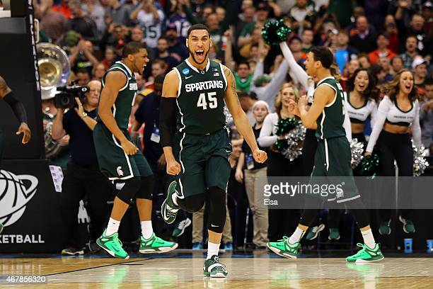 Denzel Valentine of the Michigan State Spartans celebrates after defeating the Oklahoma Sooners 62 to 58 during the East Regional Semifinal of the...