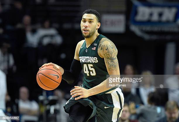 Denzel Valentine of the Michigan State Spartans dribbles the ball up the court against the Penn State Nittany Lions during the second half at the...