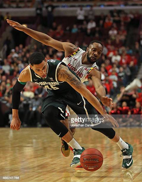 Denzel Valentine of the Michigan State Spartans is chased by Dez Wells of the Maryland Terrapins during the semifinal round of the 2015 Big Ten Men's...