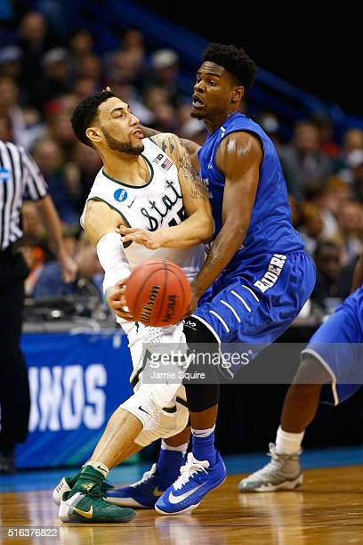 Denzel Valentine of the Michigan State Spartans looks to pass against Aldonis Foote of the Middle Tennessee Blue Raiders in the second half during...