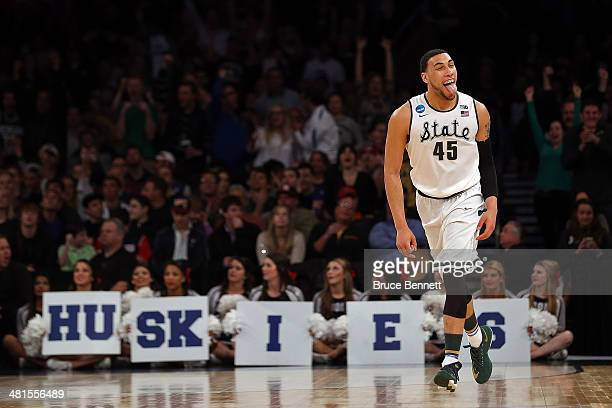 Denzel Valentine of the Michigan State Spartans reacts after hitting a three pointer late in the first half against the Connecticut Huskies during...