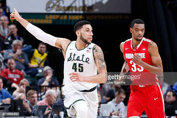 Denzel Valentine of the Michigan State Spartans reacts after making a threepoint shot against the Ohio State Buckeyes in the quarterfinal round of...