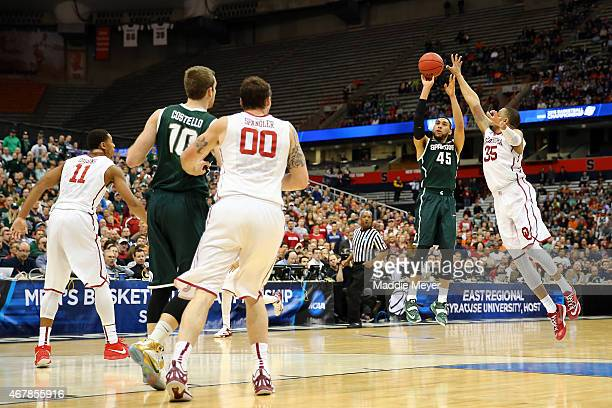 Denzel Valentine of the Michigan State Spartans shoots a three pointer in the second half of the game against TaShawn Thomas of the Oklahoma Sooners...