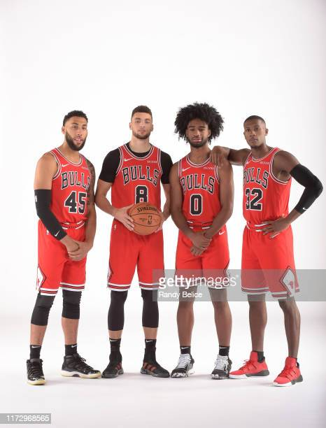 Denzel Valentine Zach LaVine Coby White and Kris Dunn of the Chicago Bulls pose for a portrait during 2019 NBA Media Day on September 30 2019 at the...