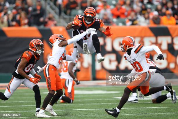 Denzel Ward of the Cleveland Browns attempts to tackle Joe Mixon of the Cincinnati Bengals during the third quarter at Paul Brown Stadium on November...