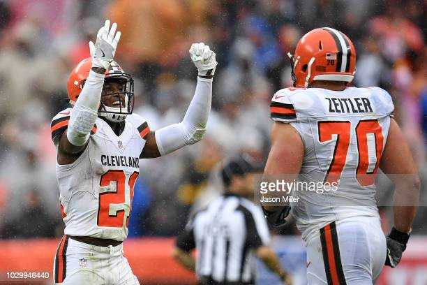 Denzel Ward of the Cleveland Browns celebrates with Kevin Zeitler after intercepting a pass during the second quarter against the Pittsburgh Steelers...