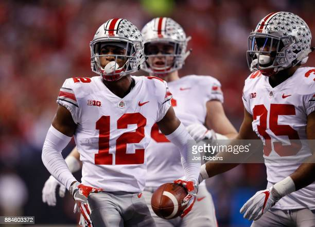Denzel Ward of the Ohio State Buckeyes celebrates an interception against the Ohio State Buckeyes in the first half during the Big Ten Championship...