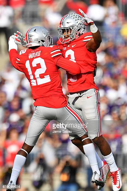 Denzel Ward of the Ohio State Buckeyes celebrates with Damon Arnette of the Ohio State Buckeyes after Arnette intercepted a pass in the first quarter...