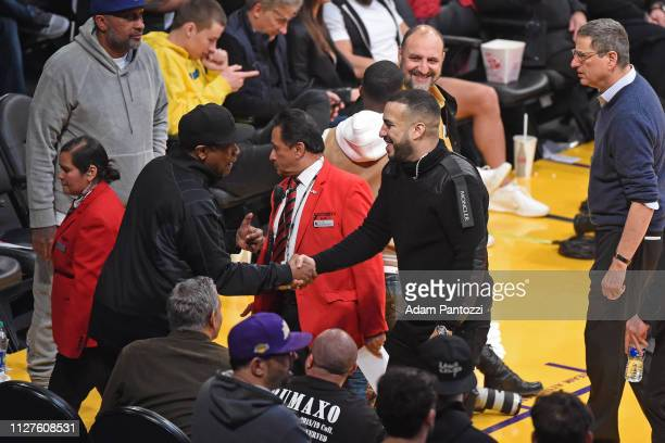 Denzel Washington and French Montana exchange hifives during the game between the Los Angeles Lakers and the Houston Rockets on February 21 2019 at...
