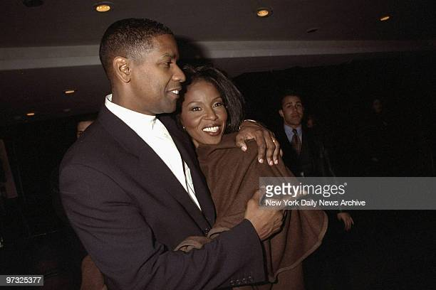 Denzel Washington and his wife attending premiere of 'The Preacher's Wife' at Roseland
