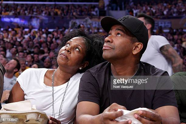 Denzel Washington and his wife Pauletta attend the Houston Rockets v Los Angeles Lakers Game Seven of the Western Conference Semifinals during the...