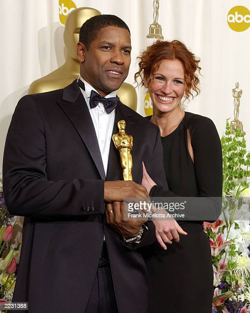 Denzel Washington and Julia Roberts backstage at the 74th Annual Academy Awards held at the Kodak Theatre in Hollywood Ca March 24 2002 photo by...