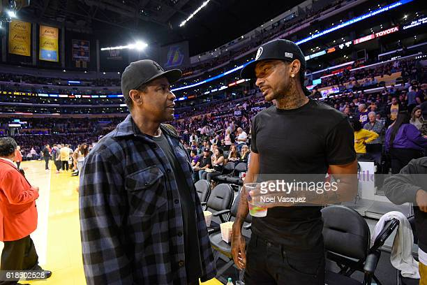Denzel Washington and Nipsey Hussle attend a basketball game between the Houston Rockets and the Los Angeles Lakers at Staples Center on October 26...