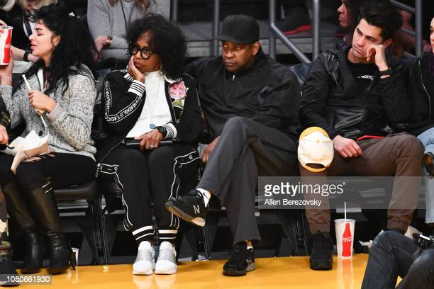 Denzel Washington and Pauletta Washington attend a basketball game between the Los Angeles Lakers and the Miami Heat at Staples Center on December 10...