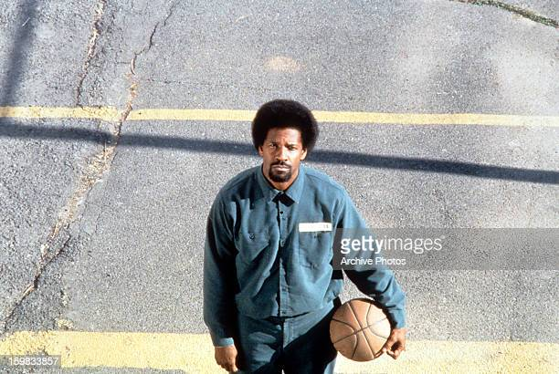 Denzel Washington holds a basketball in a scene from the film 'He Got Game' 1998