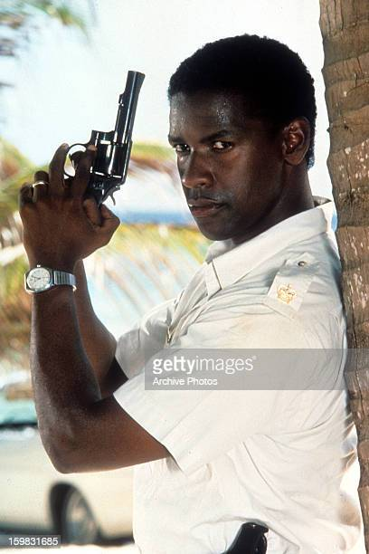 Denzel Washington holds a gun in a scene from the film 'The Mighty Quinn', 1989.