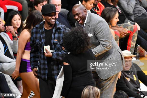 Denzel Washington Magic Johnson and Pauletta Washington attend a basketball game between the Los Angeles Lakers and and the Minnesota Timberwolves at...