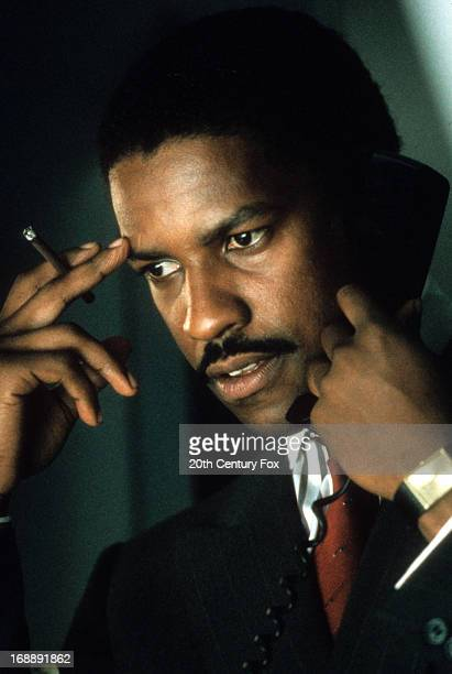Denzel Washington makes a phone call in a scene from the film 'Power', 1986.