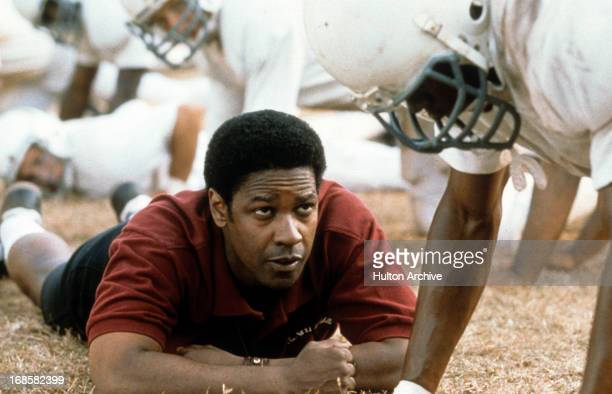 Denzel Washington motivates football players in a scene form the film 'Remember The Titans', 2000.