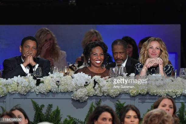 Denzel Washington Pauletta Washington and Julia Roberts attend the 47th AFI Life Achievement Award honoring Denzel Washington at Dolby Theatre on...