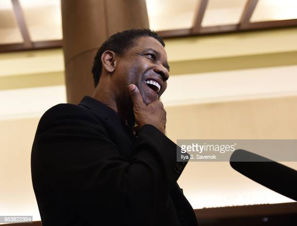 Denzel Washington speaks to a reporter at the 2018 Tony Awards Meet The Nominees Press Junket on May 2 2018 in New York City
