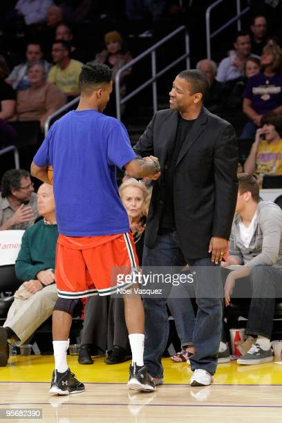 Denzel Washington talks to Brandon Jennings of the Milwaukee Bucks at a game between the Milwaukee Bucks and the Los Angeles Lakers at Staples Center...