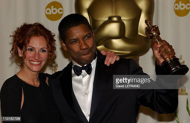 Denzel Washington winner Best Actor with Julia Roberts in the Press Room at the Seventy Fourth Annual Academy Awards in Los Angeles United States on...