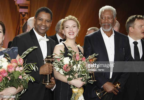 Denzel WashingtonScarlett Johansson and Morgan Freeman pose for a final picture at the 47th Golden Camera Awards at the Axel Springer Haus on...