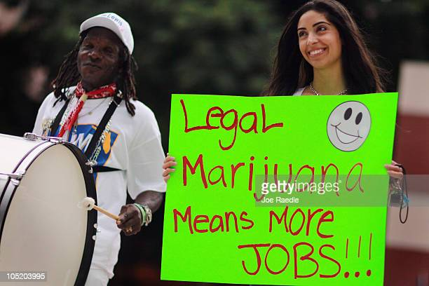 Denzil McLean and Priscilla Nova attend a rally for Florida Attorney General candidate Jim Lewis who is running on a platform of legalizing marijuana...
