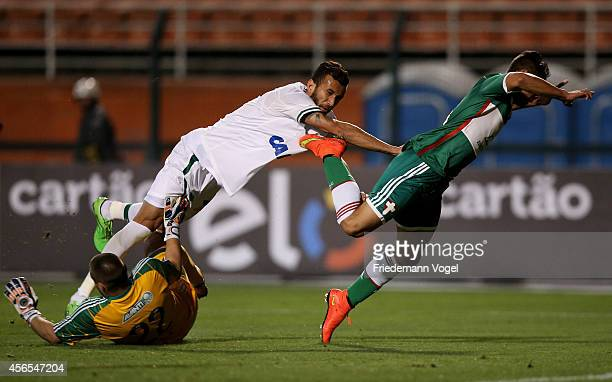 Deola and Joao Pedro of Palmeiras fights for the ball with Bruno Rangel of Chapecoense during the match between Palmeiras and Chapecoense for the...