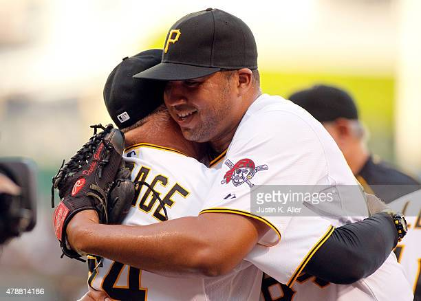Deolis Guerra of the Pittsburgh Pirates celebrates with pitching coach Ray Searage after his major league debut in the ninth inning during the game...