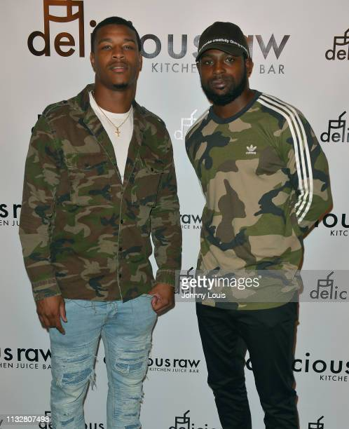 Deon Bush and Rashawn Scott attend an intimate dinner experience at Delicious Raw restaurant on February 27 2019 in Miami Beach Florida