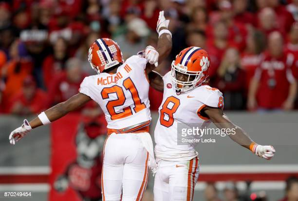Deon Cain celebrates after scoring a touchdown with teammate RayRay McCloud of the Clemson Tigers during their game against the North Carolina State...