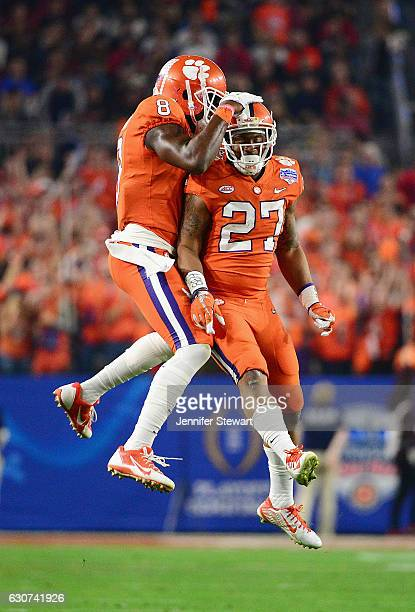 Deon Cain of the Clemson Tigers and CJ Fuller react during the first half of the 2016 PlayStation Fiesta Bowl at University of Phoenix Stadium on...