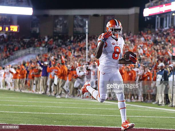 Deon Cain of the Clemson Tigers beats Gabriel McClary of the Boston College Eagles in to the end zone for a touchdown in second half against the...
