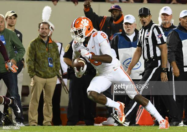 Deon Cain of the Clemson Tigers carries the ball during the second quarter against the Virginia Tech Hokies at Lane Stadium on September 30 2017 in...