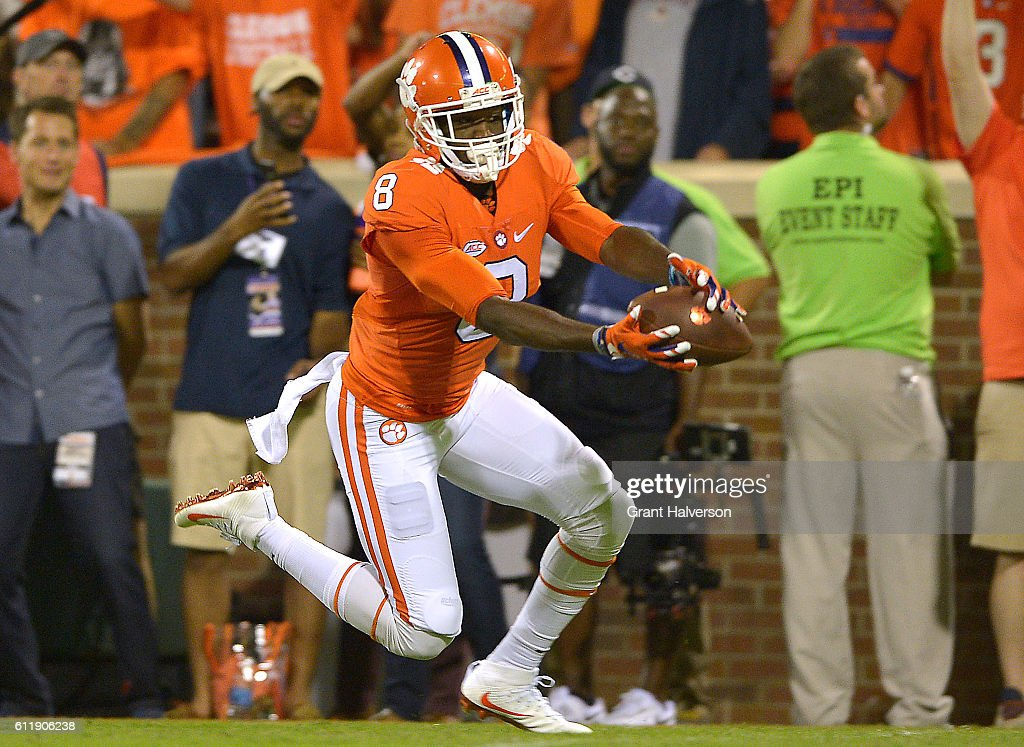 Deon Cain #8 of the Clemson Tigers catches a second quarter touchdown reception against the Louisville Cardinals at Memorial Stadium on October 1, 2016 in Clemson, South Carolina.