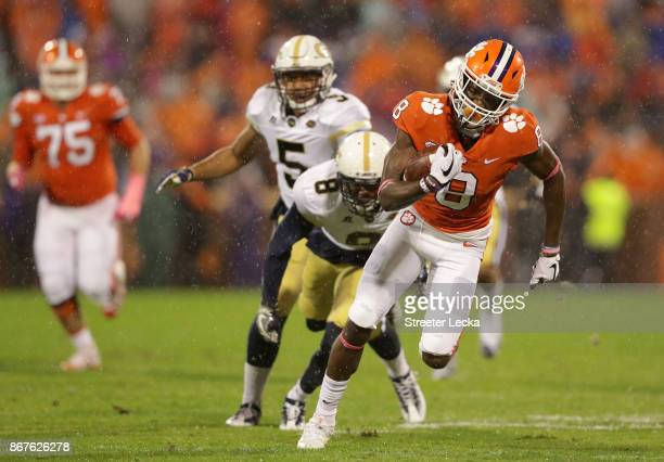 Deon Cain of the Clemson Tigers catches a touchdown pass against the Georgia Tech Yellow Jackets during their game at Memorial Stadium on October 28...