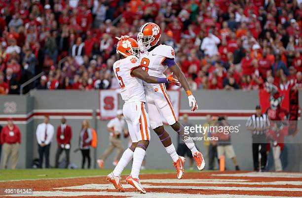 Deon Cain of the Clemson Tigers celebrates catching a touchdown pass with teammate Germone Hopper during their game against the North Carolina State...