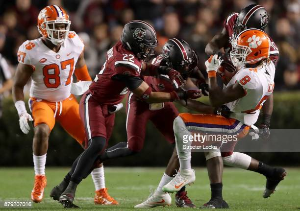 Deon Cain of the Clemson Tigers makes a catch against Steven Montac of the South Carolina Gamecocks during their game at WilliamsBrice Stadium on...