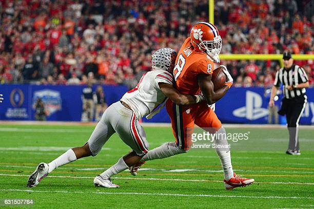 Deon Cain of the Clemson Tigers runs with the ball against the Ohio State Buckeyes during the 2016 PlayStation Fiesta Bowl at University of Phoenix...