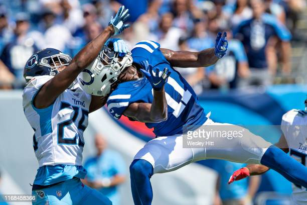 Deon Cain of the Indianapolis Colts is interfered with during a pass attempt by Adoree Jackson of the Tennessee Titans at Nissan Stadium on September...