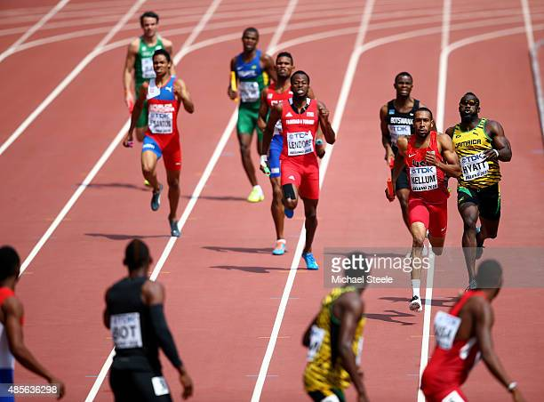Deon Lendore of Trinidad and Tobago Bryshon Nellum of the United States and Dane Hyatt of Jamaica prepare to change over in the Men's 4x400 Metres...