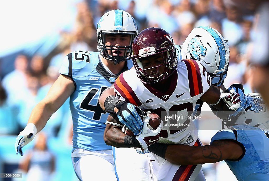 Deon Newsome #20 of the Virginia Tech Hokies runs with the ball against the defense of the North Carolina Tar Heels during their game at Kenan Stadium on October 4, 2014 in Chapel Hill, North Carolina.