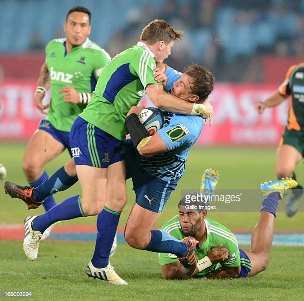 Deon Stegmann of Bull tackled by Tino Nemani and Colin Slade of Highlanders during the Super Rugby match between Vodacom Bulls and Highlanders from...