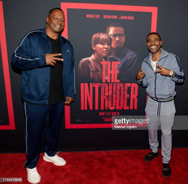 Deon Taylor and Lil Duvall attend The Intruder Atlanta red carpet screening at Regal Atlantic Station on April 22 2019 in Atlanta Georgia