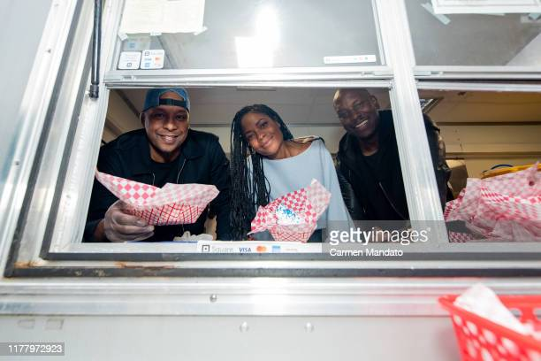Deon Taylor Tyrese Gibson and Naomie Harris are seen serving from a food truck during the Black Blue cast members' visit to Morehouse College on...
