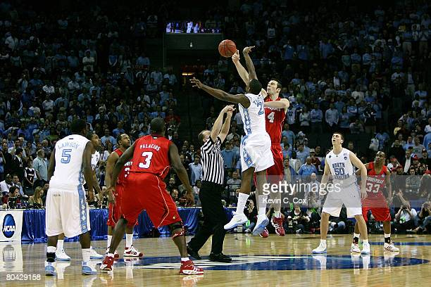 Deon Thompson of the North Carolina Tar Heels and David Padgett of the Louisville Cardinals go after the game opening tipoff during the 2008 NCAA...