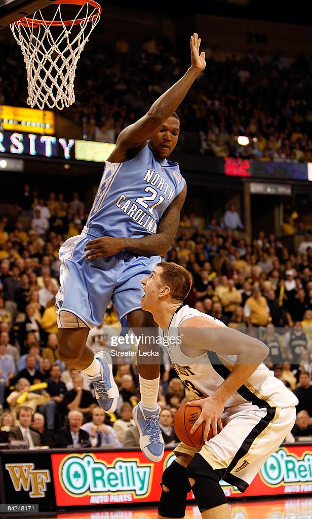 Deon Thompson #21 of the North Carolina Tar Heels fouls Chas McFarland #13 of the Wake Forest Demon Deacons during their game at Lawrence Joel Coliseum on January 11, 2009 in Winston-Salem, North Carolina.